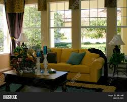 comfortable yellow couch in family living room stock photo u0026 stock