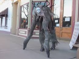this woman u0027s halloween costume is a scary 4 legged monster