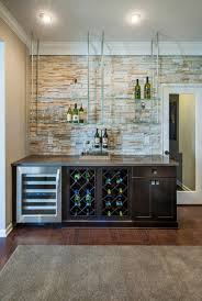 glass shelf between kitchen cabinets create a dynamic home bar with floating glass shelves that