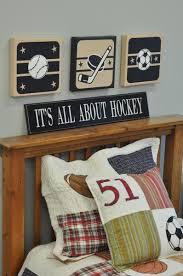 Sports Themed Wall Decor - hockey stick and puck canvas wall art boys sports themed room