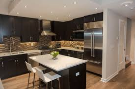 glass stainless steel hanging rang hood dark kitchen cabinets and