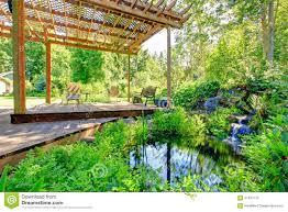 Backyard Farms Picturesque Backyard Farm Garden With Small Pond And Patio Area