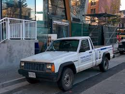 jeep pickup comanche old parked cars vancouver may 2015