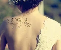 globe tattoo on back tattoomagz