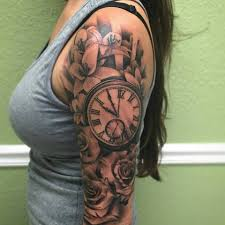 clock and flower tattoos grey flowers and clock on right
