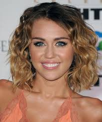 casual shaggy hairstyles done with curlingwands miley cyrus medium wavy casual bob hairstyle dark brunette hair