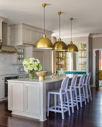 Stainless Steel Kitchen Pendant Lighting by Kitchen Style Spacious Penthouse Kitchen White Cabinets Glod