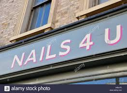 nails 4 u sign outside a nail salon stock photo royalty free