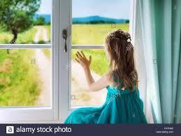 images of sad girl little sad girl looking through window stock photo 92365870 alamy
