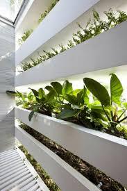haus mit wintergarten zimmerpflanzen als dekoration in szene setzen