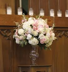 wedding flowers for church white flowers with accents in place of the pink blooms here