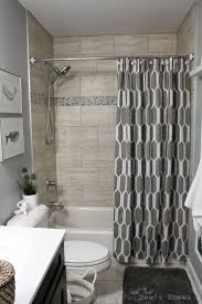 best ideas about shower makeover pinterest small bathroom love everything about this bathroom remodel the colors cute nautical theme chalkboard towel hooks shower curtain