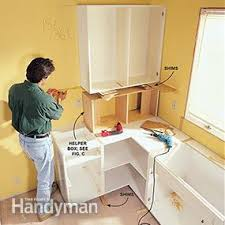 How To Mount Kitchen Wall Cabinets Frameless Kitchen Cabinets Family Handyman
