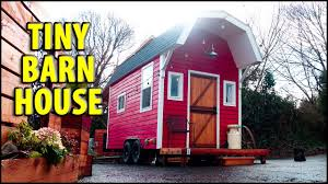 barn themed tiny house with innovative folding table design and