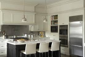 Metallic Tile Backsplash by Ivory And Black Kitchen Cabinets With Stainless Steel Hex Tile