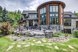 11370 valley ridge park nw dennis plintz calgary real estate agent floor to ceiling windows on custom home evergreen on the bow at 11370 valley ridge