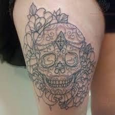 sugar skull on side thigh