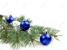 snow covered pine tree branch with blue christmas ornaments stock