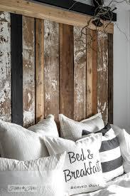 a cheater reclaimed wood barn door headboard with faux hardware