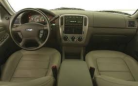 ford explorer 2004 review 2005 gmc envoy slt vs 2004 ford explorer xlt vs 2005 jeep grand