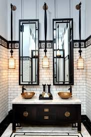 black and gold bathroom presenting white ceramic vanity cabinet