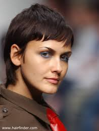 gamine hairstyles for mature women short gamine haircut with the hair styled smooth for a sexy look