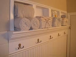Nice Bathrooms White Wall Shelf With Hooks And Baskets For Nice Bathroom