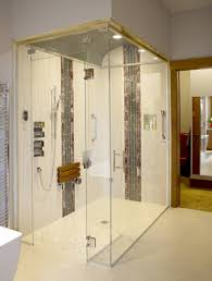 wshg net the baths have it featured the home march 6 2017 the zero threshold steam shower is accented with a series of ceramic and glass tiles the barrel vaulted ceiling is tiled in 1 inch glass mosaic tiles and a