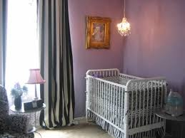 Purple Mini Chandelier Nursery With Stripes Curtains And Purple Walls Illuminated With