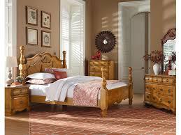 standard furniture bedroom honey pine queen cannonball bed