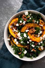 kale salad with acorn squash goat cheese and candied pecans
