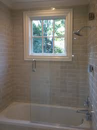 love the gray subway tiles recessed lighting and glass shower