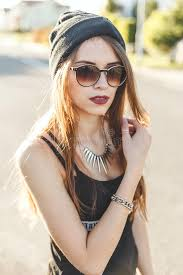 hipster girl portrait of a young stylish hipster girl dressed in dark cap and