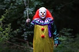 film it killer clown dressed as murderous pennywise from horror film it