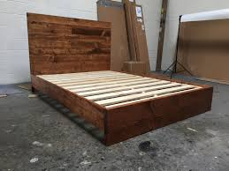 walnut wood bed frame with white bedding and curtain full size