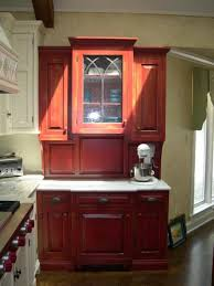 distressed hutch furniture piece in the kitchen with red color and