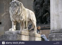 lion statue germany bavaria munich commander lion statue woman sits
