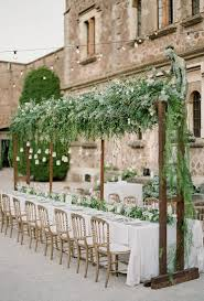 hanging greenery makes for beautiful wedding reception ceiling