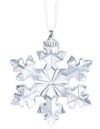 the 2012 edition of the annual swarovski ornament is delicate and