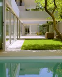 interior white and green zen exterior with beautiful grass