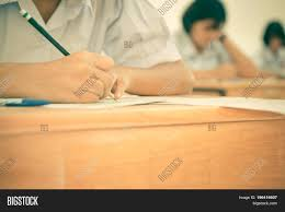 writing concept papers blurred of asian girls students writing test exams on paper for blurred of asian girls students writing test exams on paper for admissions in high school with