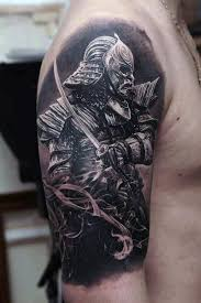 amazing samurai mask tattoo on chest for men real photo pictures