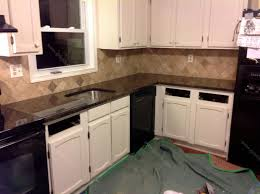 brown granite countertops with white cabinets remedios b tan brown granite countertop backsplash tile