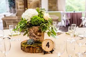 wood centerpieces birch wood centerpieces with hydrangeas and greenery and wood slab