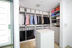 modern closet with high ceiling by california closets nashville