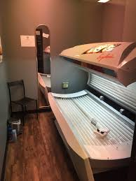 deciding between stand up and lay down tanning beds broad ripple