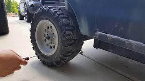 power wheels wheels jeep wrangler removing a cap nut from power wheels tire youtube