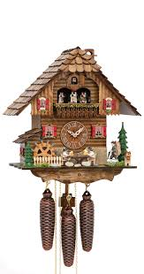 cuckoo clock black forest house with moving mill wheel beer