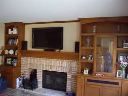 Fireplace Mantels For Tv by Custom Built In Shelves With Mantel And Tv Over Fireplace C U0026 L