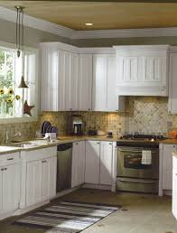 kitchen metal tile backsplash white brick kitchen cabinets brown